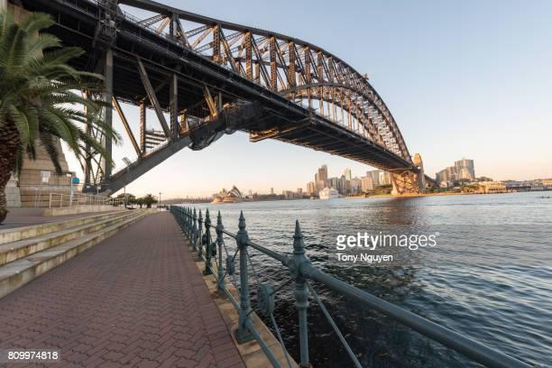 Sydney, Australia - April 15, 2017: Beautiful sunrise over Opera House and Sydney Harbour Bridge viewed from Kirribilli in North Sydney.