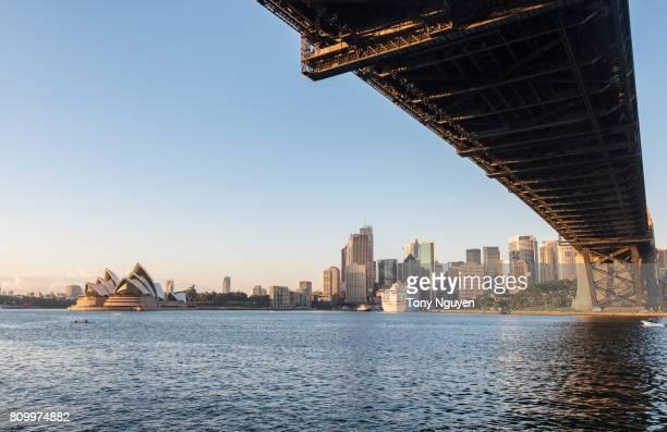 Sydney, Australia - April 15, 2017:Beautiful sunrise over Opera House and Sydney Harbour Bridge viewed from Kirribilli in North Sydney.