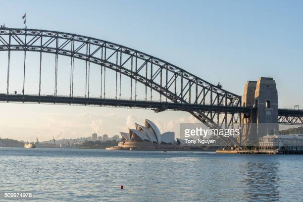 Sydney, Australia - April 15, 2017: Beautiful sunrise over Opera House and Sydney Harbour Bridge. Viewed from Blues Point Reserve in North Sydney.