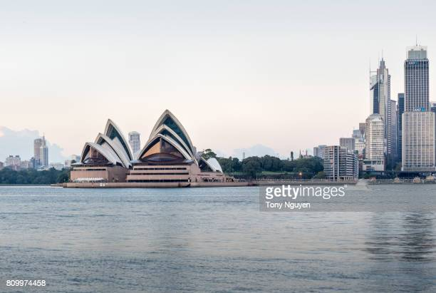 Sydney, Australia - April 15, 2017: Beautiful sunrise over Opera House with many financial towers. Viewed from Wilson Point Wharf in Kirribilli, North Sydney.