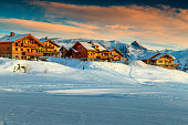 Stunning winter sunset landscape and ski resort in French Alps,Alpe D Huez,France,Europe