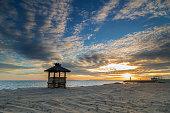 Beautiful empty beach at sunset