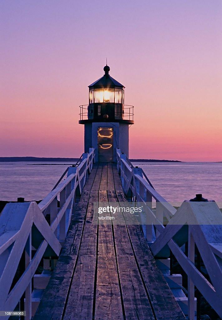 Beautiful sunset on the Marshal Point lighthouse : Stock Photo