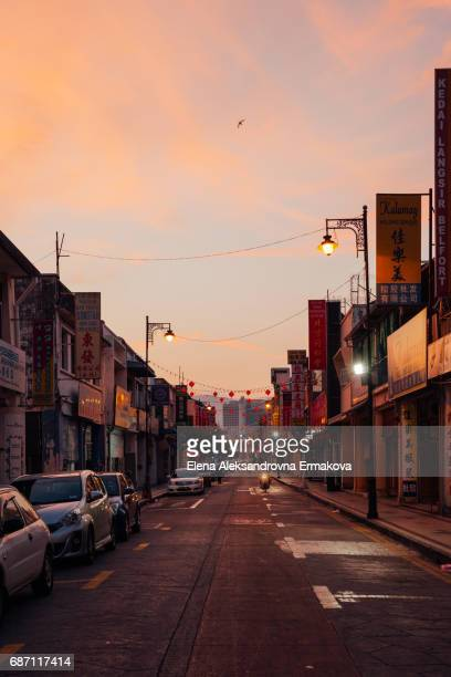 George Town, Malaysia - March 23, 2016: Beautiful sunset over the street of UNESCO heritage buffer zone, George Town, Peneng, Malaysia on March 23, 2016.