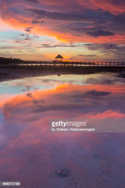 Beautiful sunset sky and Reflection in shallow sea water.