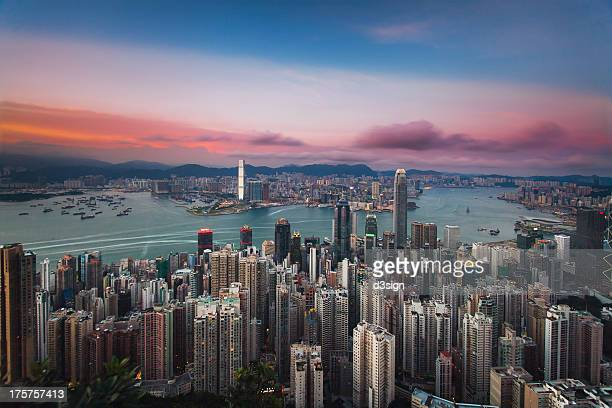Beautiful sunset sky over city skyline and harbour