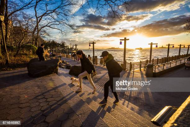 Beautiful sunset with dramatic sky in Battery Park, New York City