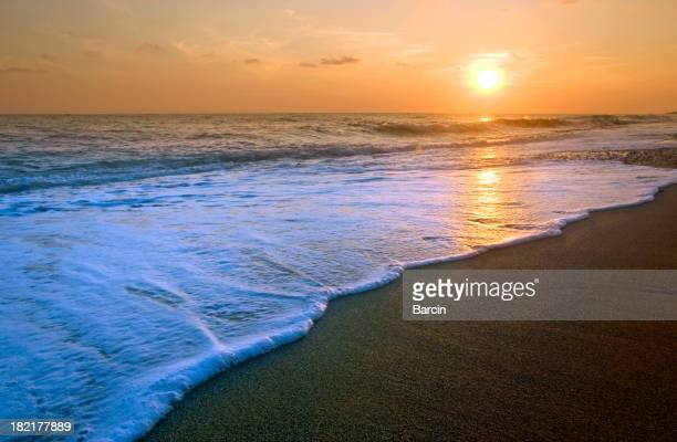 Beautiful sunset with wave at the beach