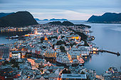 Beautiful super wide-angle summer aerial view of Alesund, Norway, with skyline and scenery beyond the city, seen from the observation deck of Aksla mountain