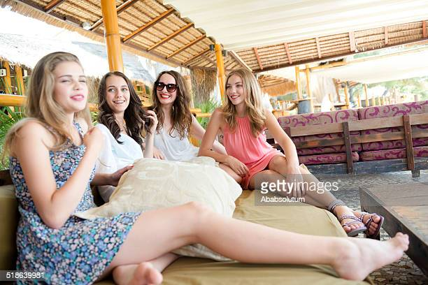 Beautiful Teenage Friends Enjoying at Beach Coctail Club, Europe