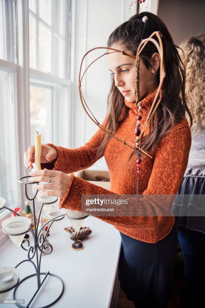 Beautiful teenage girl starting to decorate house for Christmas. : Stock Photo