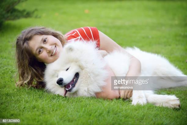 Beautiful teenager girl with Samoyed dog