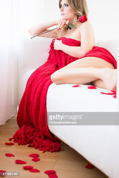 Beautiful topless woman holding red rose