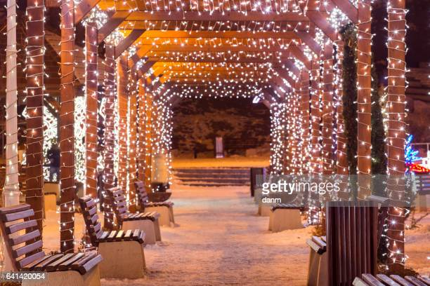 beautiful tunnel of lights with snow in the winter time