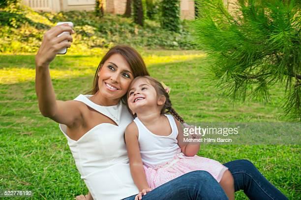 Beautiful Turkish family taking selfies