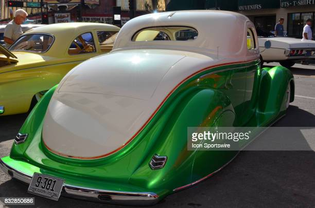 Beautiful twotone paint scheme highlights this 1936 Ford 3window coupe on display at the Hot August Nights Custom Car Show the largest nostalgic car...