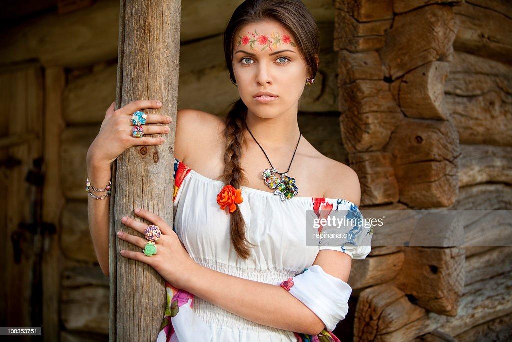 Beautiful ukrainian girl in traditional dress : Stock Photo