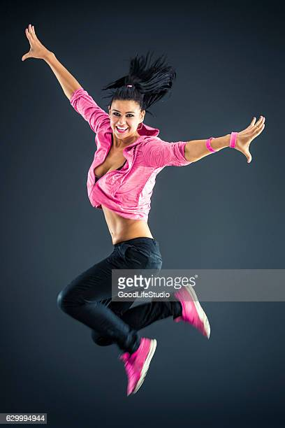 Beautiful urban dancer jumping
