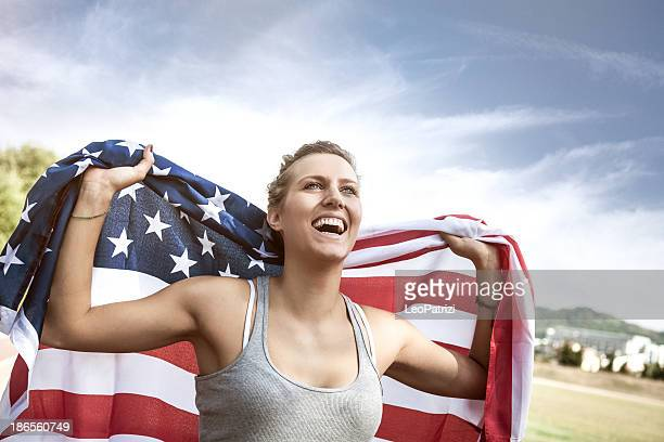 Beautiful US athlete with national flag