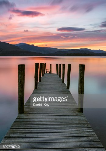 Beautiful Vibrant Pink And Purple Sunset With Wooden Jetty. : Stock Photo