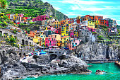 Beautiful view of Manarola town. Is one of five famous colorful villages of Cinque Terre National Park in Italy, suspended between sea and land on sheer cliffs. Liguria region of Italy.