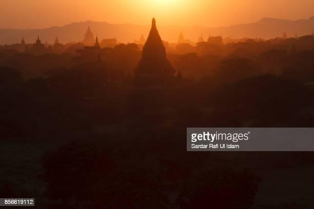 Beautiful view of pagodas against the setting sun in Bagan, Mandalay Region, Myanmar