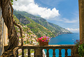 beautiful view of the town of Positano from antique terrace with flowers, Amalfi coast, Italy. balcony with flowers
