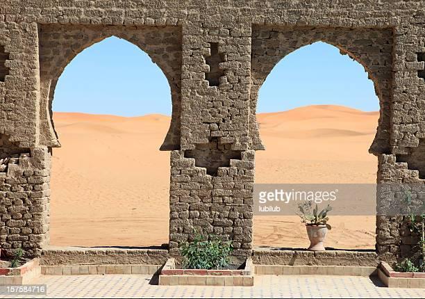 Beautiful view through arches to Erg Chebbi Dunes, Sahara, Morocco