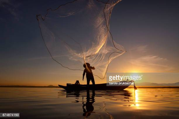 Beautiful views of Fisherman in river lifestyle sunrise.