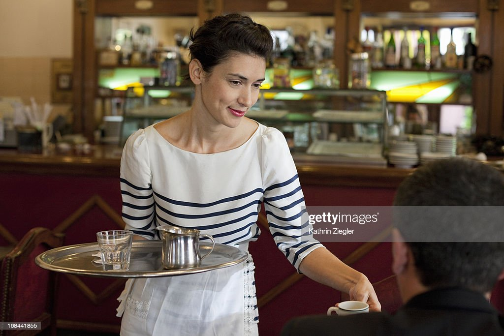 beautiful waitress serving coffee : Stock Photo