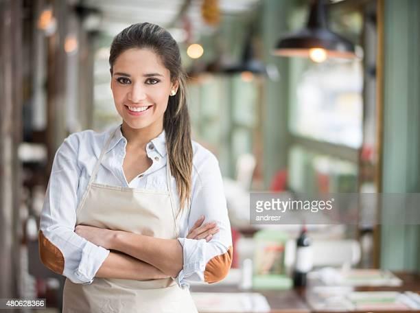 Beautiful waitress working at a restaurant