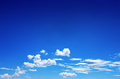 it is beautiful white clouds on blue sky for background and design.