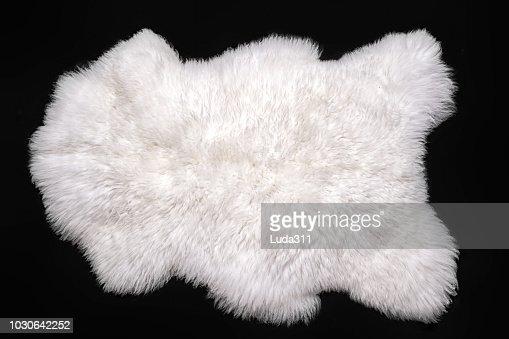 Beautiful white sheepskin isolated on a black background : Stock Photo