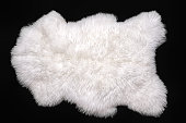 Beautiful white sheepskin isolated on a black background