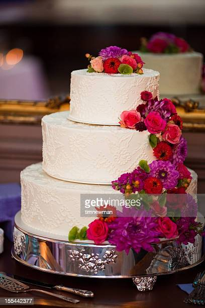 Beautiful White Wedding Cake Centerpiece and Elaborate Floral Arrangement