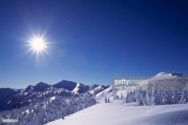 Beautiful winter mountain scene under bright sun.