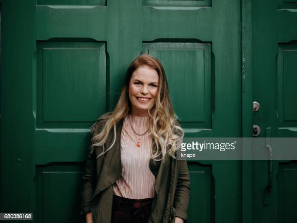 Beautiful woman agains green door