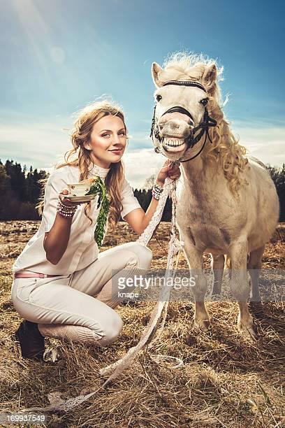 Beautiful woman and a shetland pony