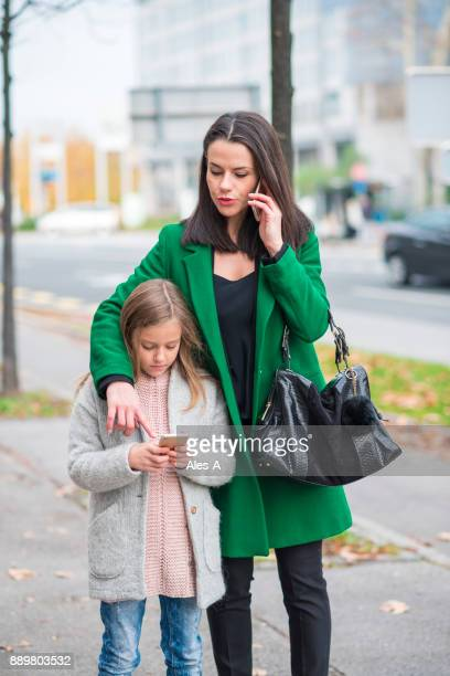 Beautiful woman and her daughter in the city