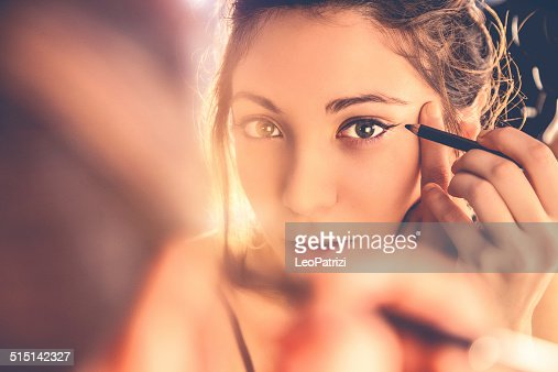 Beautiful woman applying make-up