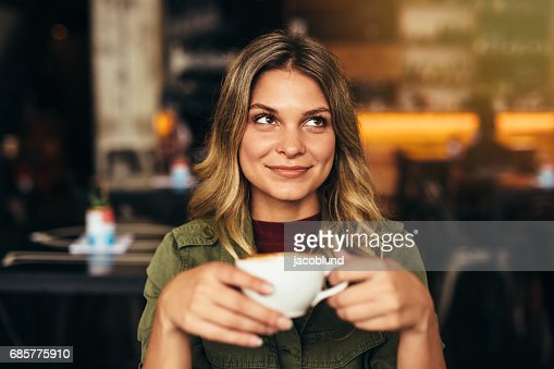 Beautiful woman at cafe with cup of coffee : Stock Photo