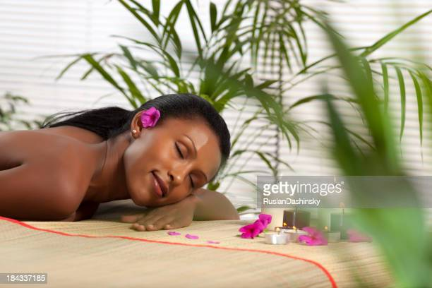 Beautiful woman at spa waiting for massage
