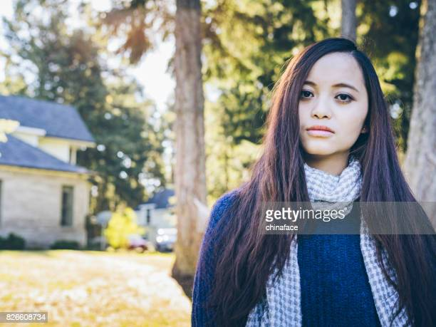 beautiful woman at yard of house