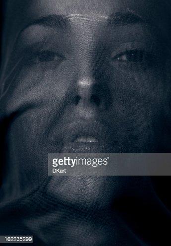 Beautiful woman behind a veil