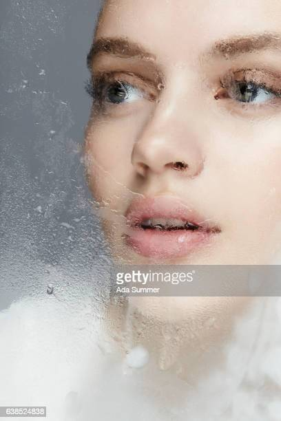 beautiful woman behind frosted glas