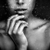 Beautiful woman behind window