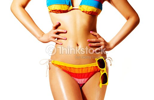 Beautiful woman body with colorful bikini isolated on white background.  Perfect body skin d9a17267f