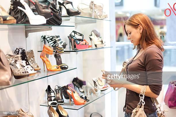 Beautiful woman buys shoes.
