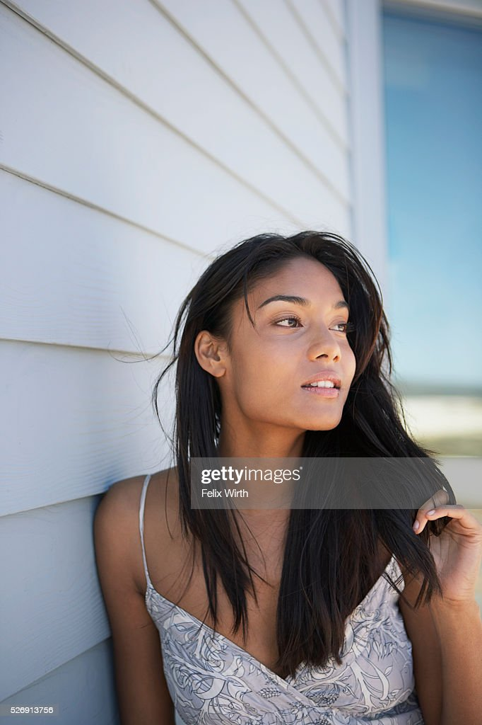 Beautiful woman by side of house : Stock-Foto