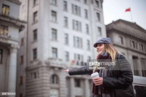 Beautiful woman catching taxi